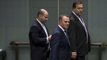 Treasurer Josh Frydenberg, Goldstein MP Tim Wilson and Mackellar MP Jason Falinski in Parliament in 2019.