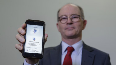 Deputy Chief Medical Officer Professor Paul Kelly with the COVIDSafe app on his phone.