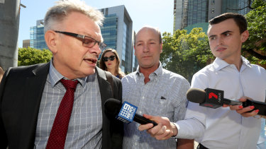 Peter Seppelt (centre) at the Adelaide Magistrates Court .