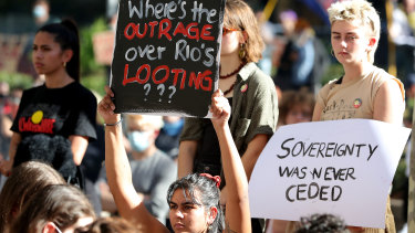 Protesters are seen during a rally outside the Rio Tinto office in Perth.