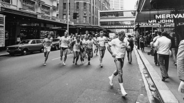 The City Tattersalls Harriers runners on Castlereagh Street, led by gymnasium director George Daldry.