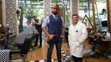 Professor Prashant Sonar (right) with Benjamin Mir, who runs the Ben Scissorhands barber shop in Kelvin Grove.