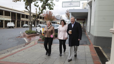 Kristy McBain and Anthony Albanese walk a cold, empty street in Yass with Yass Valley mayor Rowena Abbey (left).
