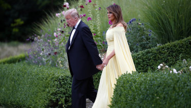 US President Donald Trump and first lady Melania Trump leave Winfield House, residence of the US ambassador, before boarding Marine One helicopter for the flight to nearby Blenheim Palace.