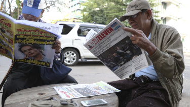 Yangon locals read newspapers headlined with Aung Sun Suu Kyi's appearance at The Hague.