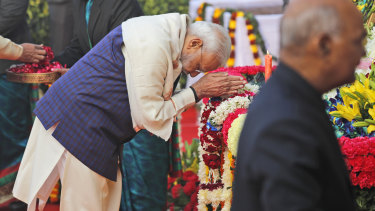 Indian Prime Minister Narendra Modi pays tribute on the death anniversary of BR Ambedkar at parliament house in New Delhi on Friday. Ambedkar, the father of the Indian Constitution, was also a freedom fighter, social reformer and a politician.