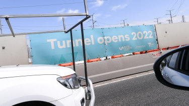 West Gate Tunnel signs on the West Gate Freeway advertising its completion in 2022.