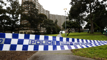 Police tape outside the public housing tower on Alfred Street.
