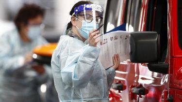 A coronavirus tester at work.