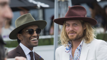 Milliner Nick Fouquet (right) arrives at the cup.