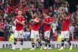 Manchester United players wave to the crowd following the English Premier League soccer match between Manchester United and Leeds United at Old Trafford on August 14.