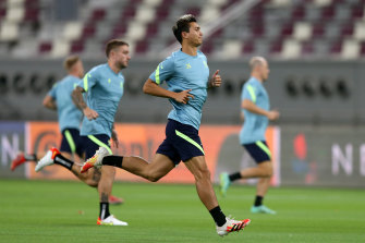 Australia players attend a training session ahead of the FIFA 2022 World Cup Qualifier in Khalifa International Stadium. The pitchside air vents can be seen in the background.