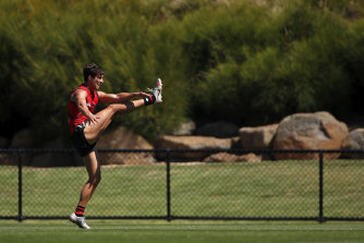 Former Giants midfielder Jye Caldwell lets fly during an Essendon training session.