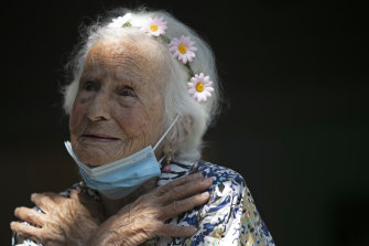 Zelia de Carvalho Morley, 106, gestures before receiving a shot of China's Sinovac CoronaVac vaccine at the retirement home where she lives in Rio de Janeiro, Brazil.