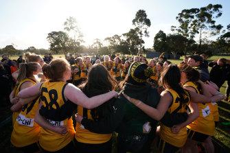 St Mary's women's team celebrate winning the B-grade premiership in 2018.