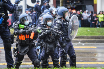 Riot police move in to control a violent protest outside the CFMEU offices on Monday.