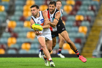 Stephen Coniglio is put under pressure by Paddy Ryder.
