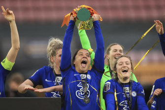Chelsea's Sam Kerr with the FA Women's League Cup at Vicarage Road on Sunday.