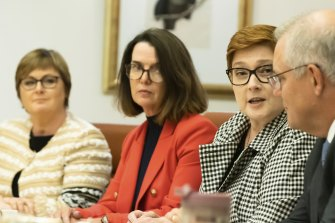 Minister for Government Services and Minister for the NDIS Linda Reynolds, Minister for Families and Social Services and Minister for Women's Safety Anne Ruston, Minister for Foreign Affairs Marise Payne and Prime Minister Scott Morrison during the cabinet women's taskforce meeting at Parliament House in Canberra on April 6.