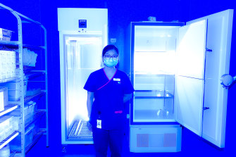 Pharmacist Lei Ching Yeoh with an ultra-low temperature freezer at the vaccination hub at Sunshine Hospital.