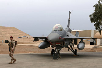 F-16 fighter aircraft are maintained at the Balad airbase north of Baghdad.