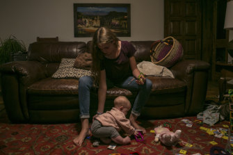 Evelyn Langford, 13, Christina's youngest sister, plays with Faith, Christina's daughter who survived the ambush.