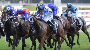 Nick of time: John Allen brings Kenedna down the outside with a late run to win the Coolmore Legacy Stakes.