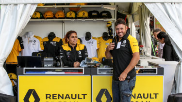 Luke Lawry buys some merchandise from the Renault Formula 1 pop-up shop at Southern Cross Station. Renault products have been very popular ahead of Australian driver Daniel Ricciardo's first race for the F1 team.