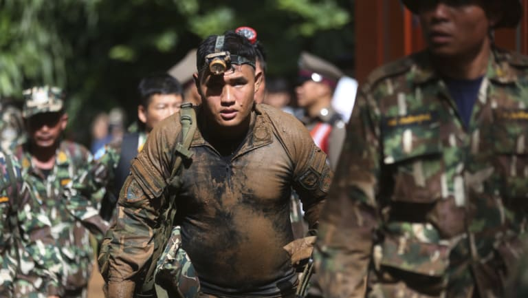 Thai soldiers march out of the Tham Luang Nang Non cave in Mae Sai, Chiang Rai province.