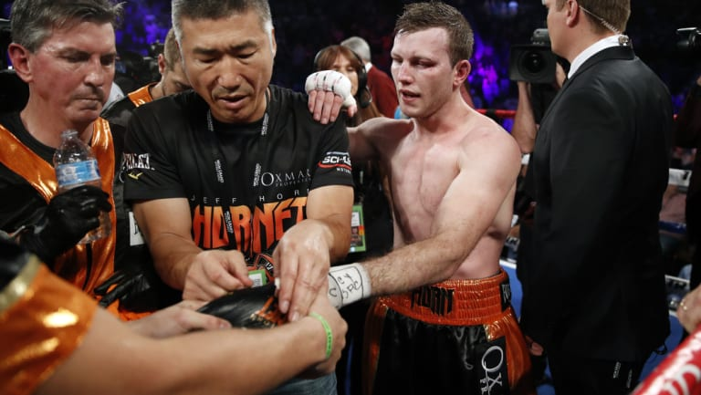Painful lesson: Jeff Horn has his gloves removed after suffering a ninth-round TKO against Terence Crawford.