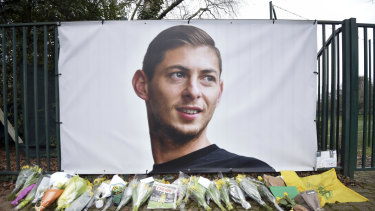 Tribute: Flowers near a giant picture of Emiliano Sala outside FC Nantes.