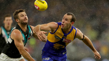 West Coast's Shannon Hurn battles Sam Gray in the wet.