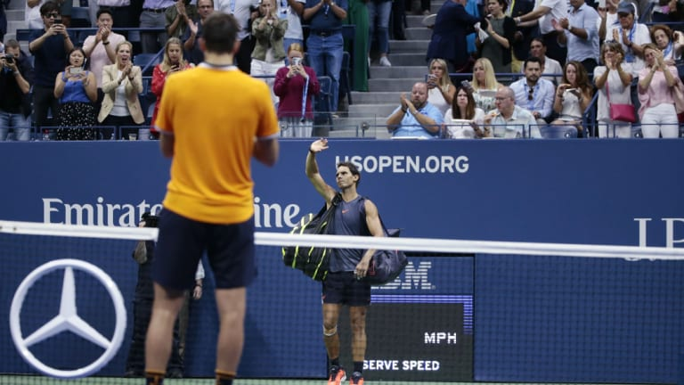 Light work: Del Potro watches on as Rafael Nadal withdraws from their US Open semi-final.