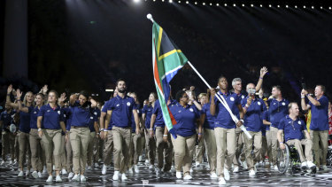 The South African team enters the arena for the Commonwealth Games. More trade would particularly help African nations.