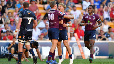 Queensland's Tate McDermott celebrates with Bryce Hegarty in their win over the Brumbies on Sunday.