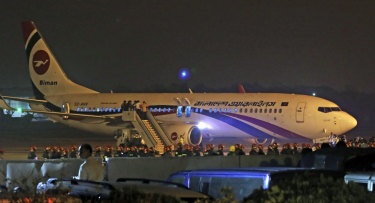 The Biman Bangladesh Airlines flight is seen after making an emergency landing at the airport in Chittagong.