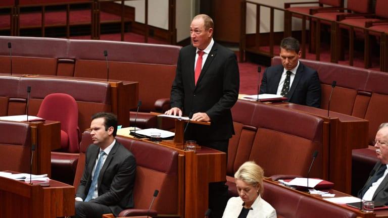 Katter's Australian Party Senator Fraser Anning (centre) makes his maiden speech in the Senate.