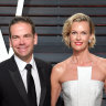 Lachlan and Sarah Murdoch slip into Australia