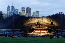 With Melbourne's skyline as backdrop, spectators arrive for a concert at the Sidney Myer Music Bowl in 2001.