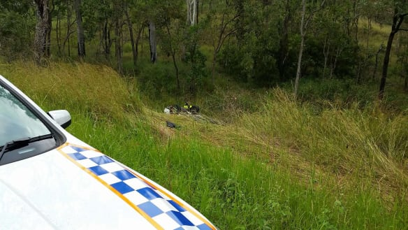 Driver found dead in rolled car off highway near Gympie