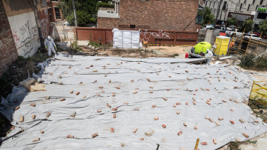A crew removes further small remnants of asbestos from the Corkman site in Carlton on Thursday.