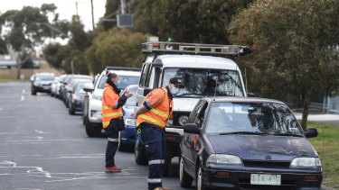 Cars line up at a coronavirus testing site on Tuesday in Fawkner, one of the suburbs included in the lockdown.