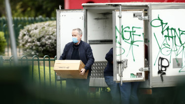 Bill Shorten delivers food to the Flemington towers on July 6.