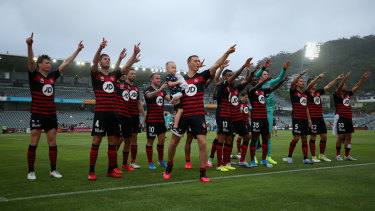 Wanderers celebrate with fans at fulltime after their win over the Central Coast Mariners.