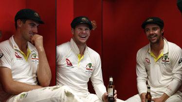 Pat Cummins (left), Steve Smith and Travis Head celebrate Australia's retention of the Ashes in September.
