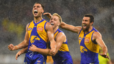 Singing in the rain: Nic Read celebrates a goal on debut for the Eagles amid a brief downpour at Optus Stadium in Perth.