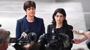 Sarah Atkinson from Maurice Blackburn Lawyers (left) and Katie Robertson from the Human Rights Law Centre speak  to media outside the Brisbane magistrates court in Brisbane on Monday.