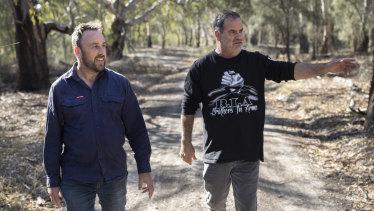 Environmental Justice Australia lawyer Bruce Lindsay and Brendan Kennedy walk near the lagoon.