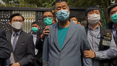 Apple Daily founder Jimmy Lai, centre, was arrested in April last year.