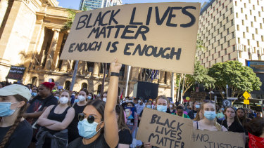 Protesters participate in a Black Lives Matter rally in Brisbane on Saturday.